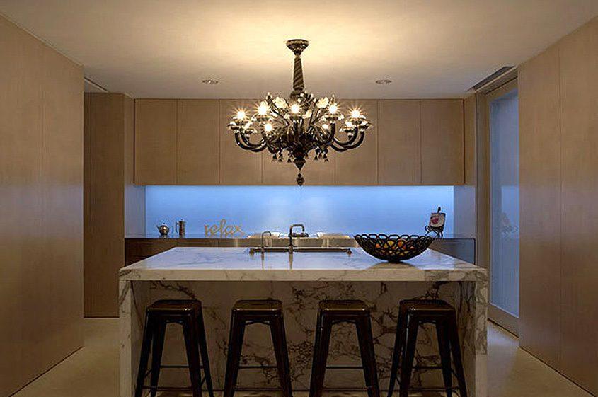 spare modern kitchen marble island, chandelier simplicity