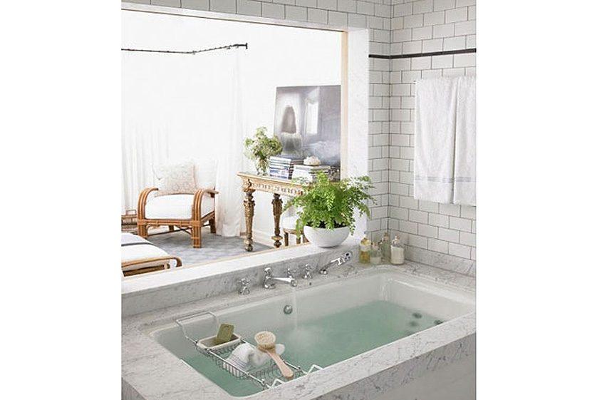 soaking tub tile marble antique table large bathroom