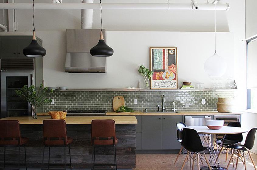 modern simple clean lined green tile backsplash leather stools black vintage lighting