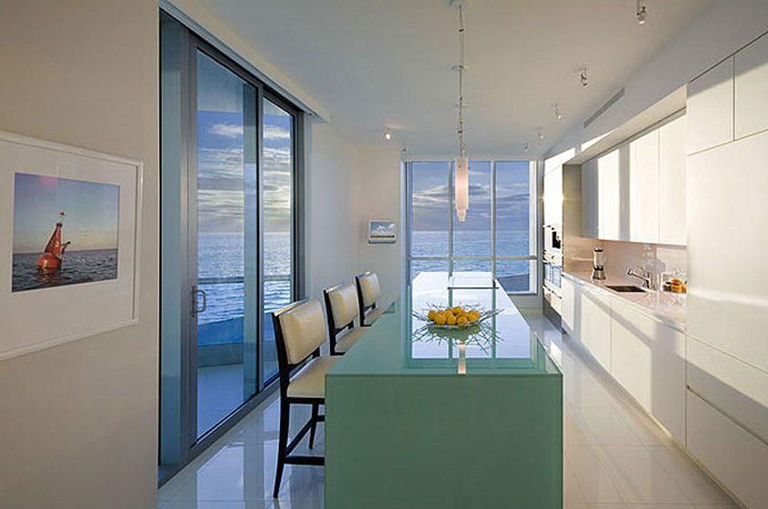 Miami Beach condo kitchen green/blue glass island white spare clean lined kitchen