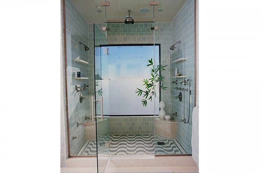 blue tile all walls in shower glass wavy patterned tile floor