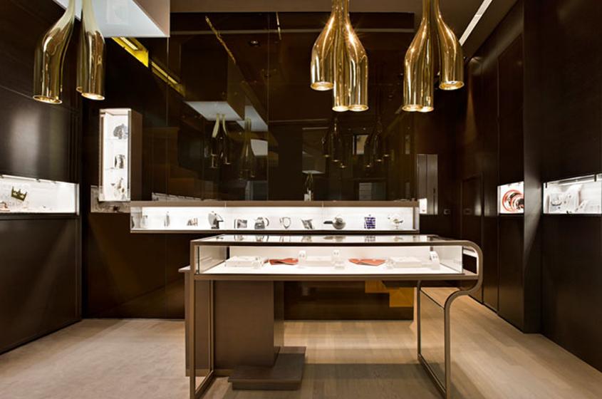 fine jewelry retail shop Milan, Italy, cases evoke jewelry lighting looks like earrings