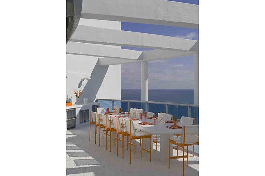 Miami condo white orange patio furniture on high rise terrace