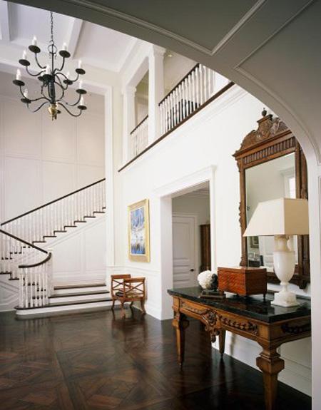 Los Angeles stairway antique table dark stained wood floor elegance