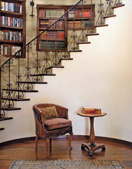 stairway iron railing detail stone walls books