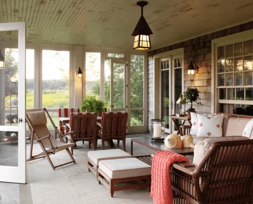Bridgehampton porch, wicker furniture, white and red tones, shingle style
